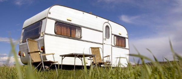 a caravan in a field of grass